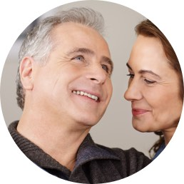 Couple smile after having Dental Implant Treatment
